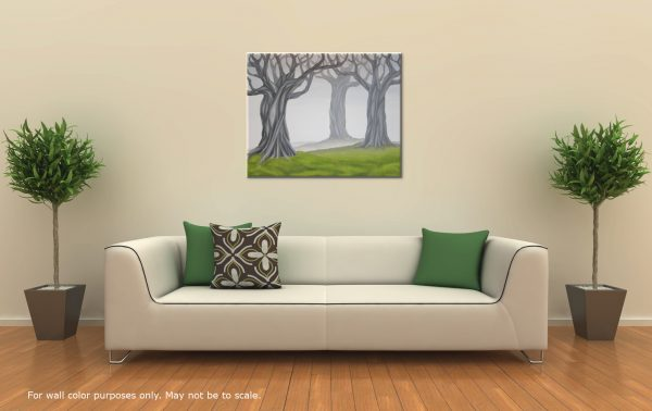 Large landscape painting of gray trees and green grass displayed in a room with neutral wall color, a white sofa, and a hardwood floor.