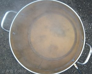 photo of maple sap being boiled in a stainless steel pot to make maple syrup