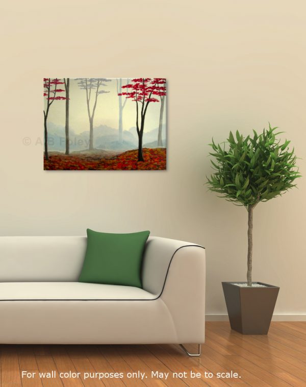 foggy autumn forest painting with red trees on a misty gray background, viewed from a distance in a room with a white sofa, white wall and a potted plant