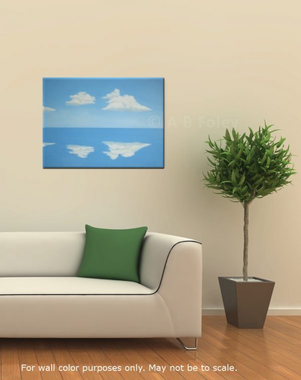 Acrylic painting of blue sky with fluffy white clouds reflected in clam blue water, viewed in situ on a neutral wall with a white couch and house plant